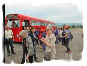Our passengers leaving the bus at Cheltenham racecourse Station, including 12 ladies in Red Hats!