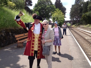 Pam with the Town Crier at Cheltenham Racecourse station