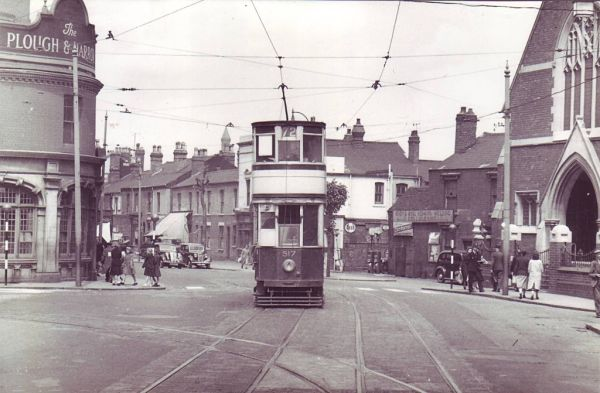 Tram on the Bristol Road in Selly Oak in 1952. the Plough & Harrow is on the left.