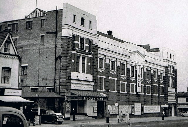 "The Tivoli Cinema on Coventry Road opposite the Swan Yardley. It opened on 17th October 1927 with Rudolph Valentino & Gloria Swanson in ""Beyond the Rocks"". The exterior of the building was designed by architect Archibald Hurley Robinson while the remainder of the building was by architectural firm Satchwell & Roberts. Seating was provided in stalls and circle levels, and the auditorium ran parallel to Coventry Road. The Tivoli Cinema was closed on 1st July 1961 with Bob Hope in ""The Facts of Life""."